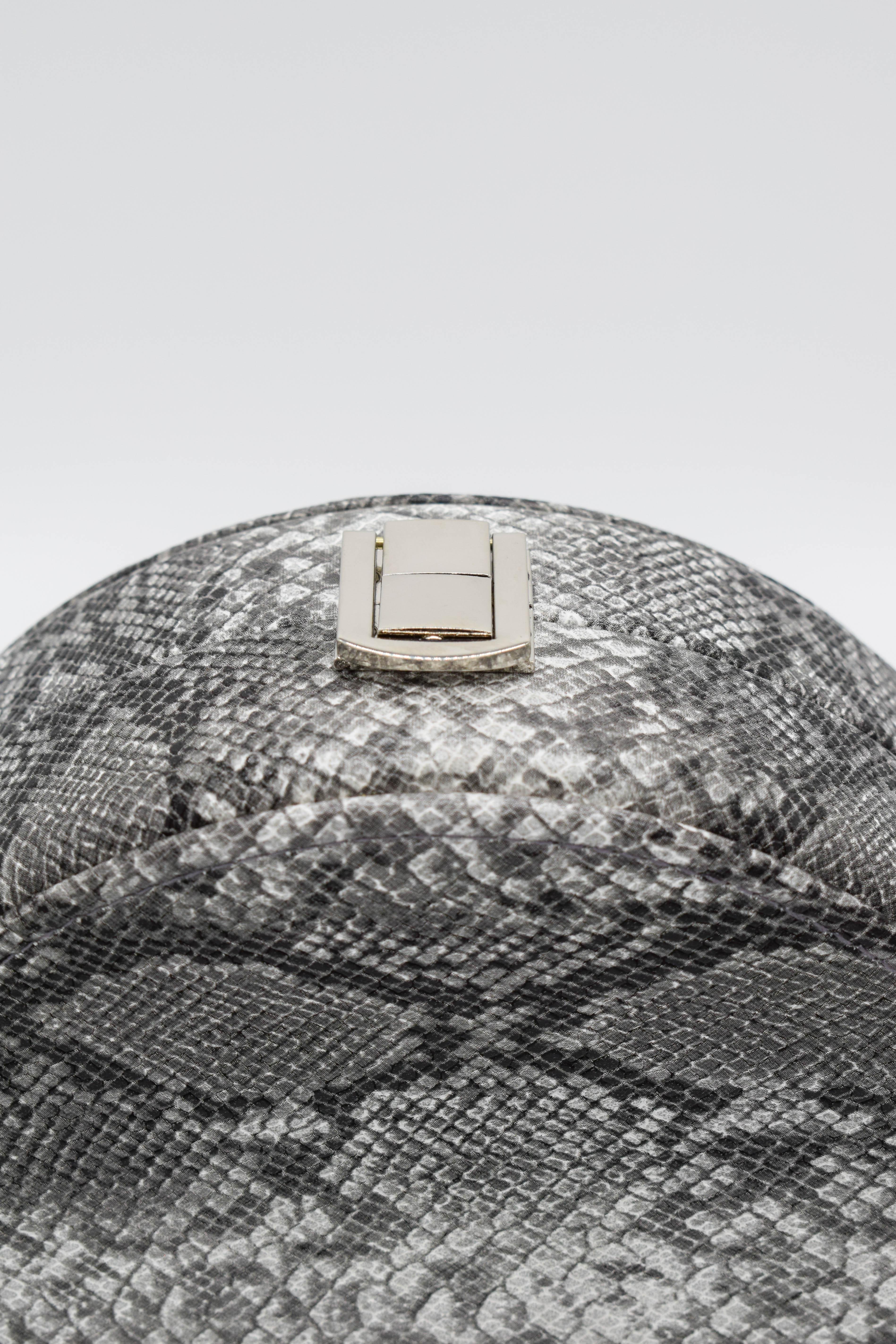 Runde Tasche Schlangenmuster