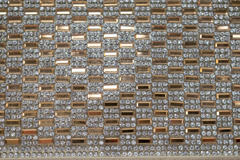 Klatsch mit Kristallverzierung in Schwarz, Gold, Silber